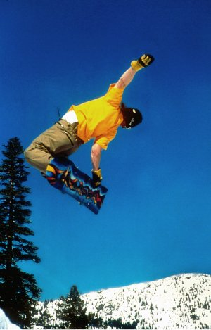 Snowboarders can find plenty of big-air to catch at the Lake Tahoe ski resorts. Photographer: Charles Shapiro. Photo courtesy of: Lake Tahoe Visitors Authority