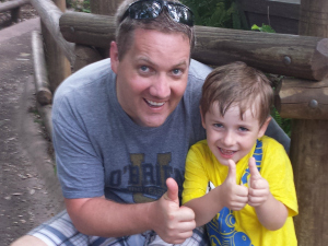 Father & Son give a 'thumbs-up' after riding Splash Mountain