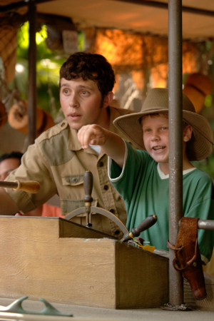 ALL ABOARD -- A young Walt Disney World guest joins the skipper on a whimsical journey aboard Jungle Cruise. This classic Disney attraction takes guess on a comical ride through the world's most famous rivers in Adventureland with surprises along the way