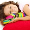 little girl on pillows