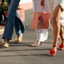 ladies walking with shopping bags